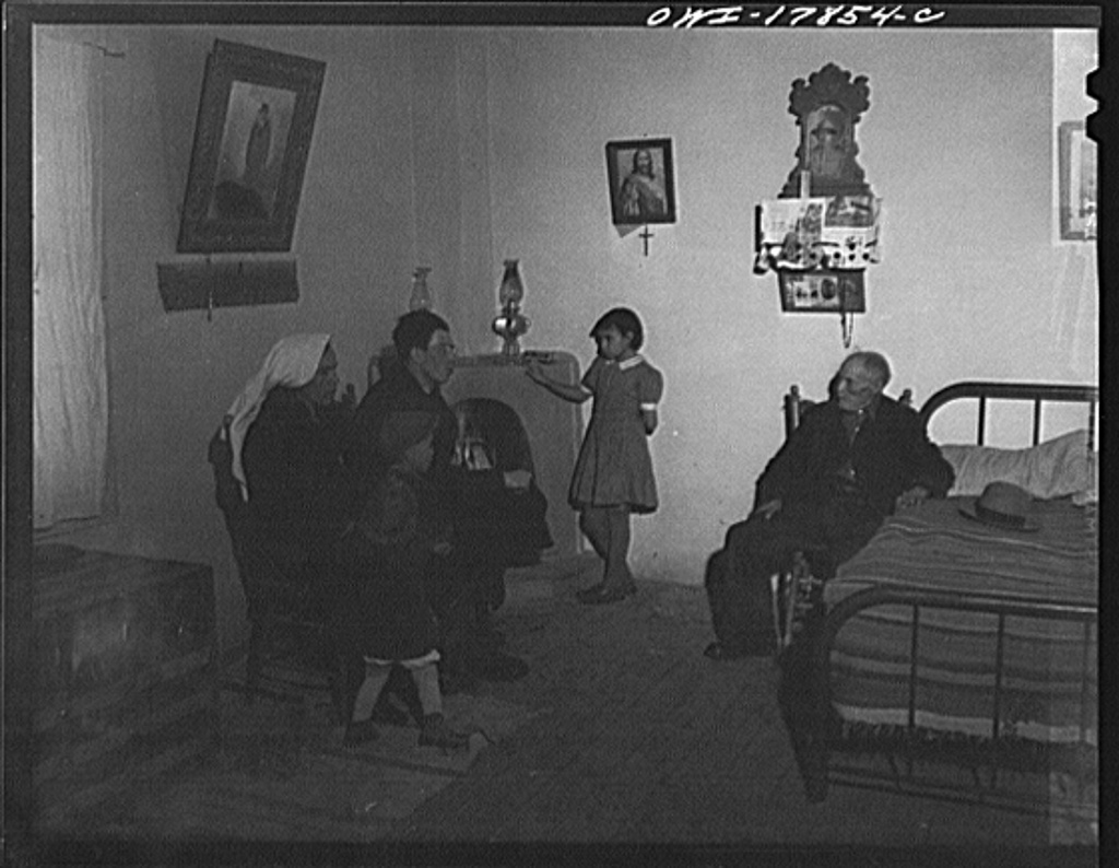Taos County, New Mexico. Father Cassidy, the Catholic priest of the parish of Penasco, advising his parishioners