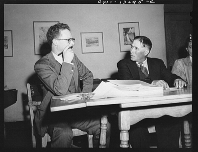 Taos, New Mexico. Jimmy Valentine, Taos County cooperative health association secretary, reasoning a point with a Spanish-American director from Chamisal