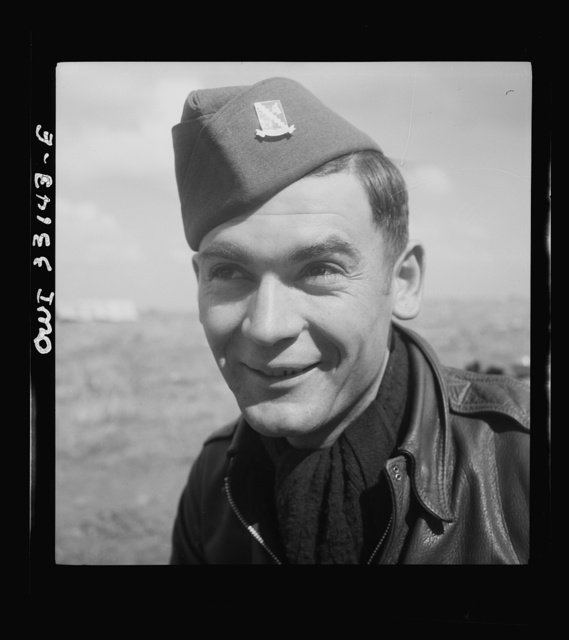 Technical Sergeant John A. Harkeli, twenty-four, gunner, of Manifold, Pennsylvania, a coal miner before the war. He is one of the original crew members of the Snow White, a B-24 bomber of the U.S. Army 9th Air Force, which has completed 300 combat hours in the Middle East