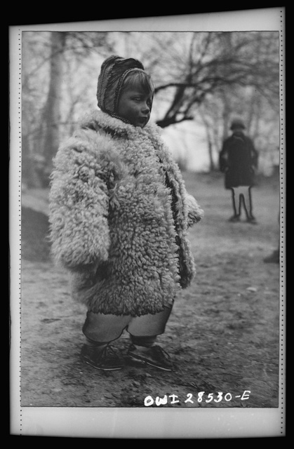 Teheran, Iran. Little Polish girl in a big sheepskin coat who is at an evacuation camp operated by the Red Cross