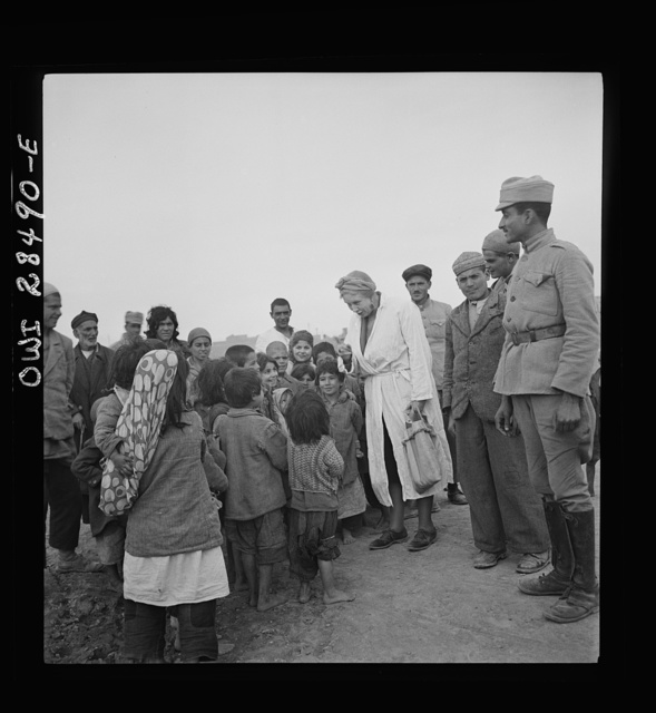 Teheran, Iran. Mrs. Louis Dreyfus, wife of the United States Minister to Iran, talking with native children