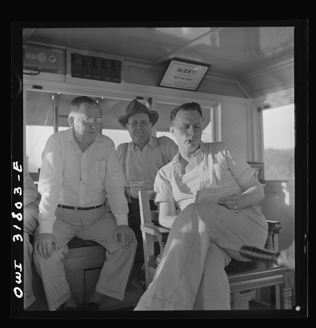 The captain and two pilots aboard the towboat Ernest T. Weir going down the Ohio River to Cincinnati