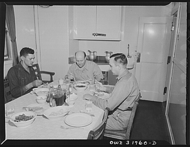 The pilot and mates eating dinner on the towboat Ernest T. Weir going down the Ohio River to Cincinnati