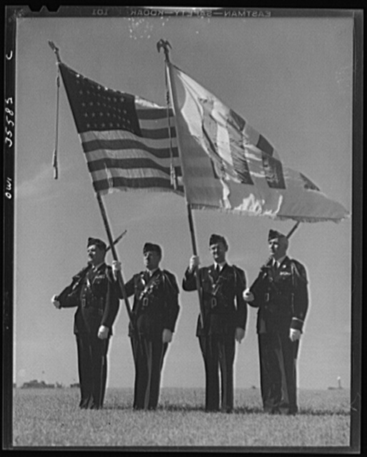 The United Nations flag, an unofficial design by Brooks B. Harding, with four bars symbolizing the Four Freedoms beside the Stars and Stripes