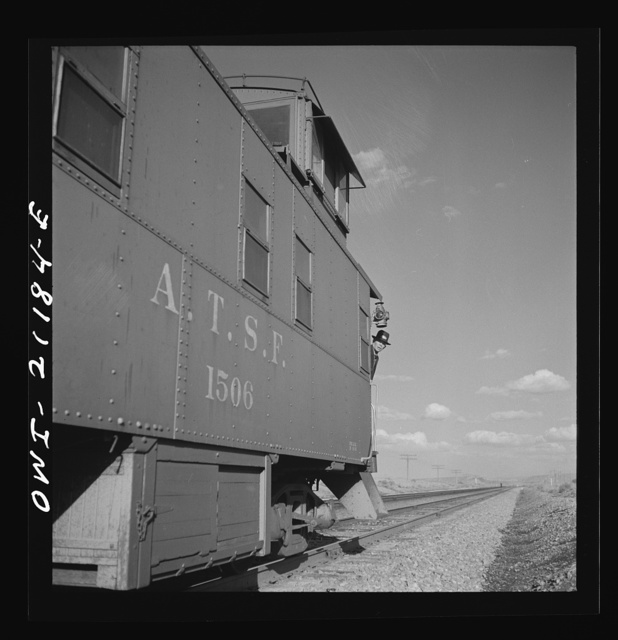 Thoreau, New Mexico. A train stopping at a siding along the Atchison, Topeka and Santa Fe Railroad between Belen and Gallup, New Mexico