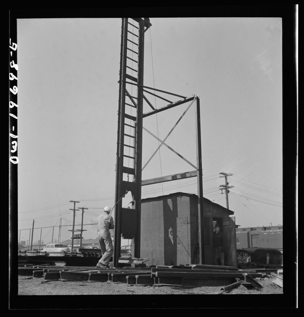 Topeka, Kansas. Breaking faulty rails at the test department of the Atchison, Topeka, and Santa Fe Railroad shops
