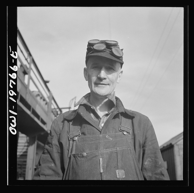 Topeka, Kansas. Claude Sweangen, steel car repairer, at the car shops of the Atchison, Topeka and Santa Fe Railroad