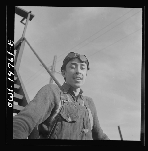 Topeka, Kansas. Eladio Tostato, steel car repairer's helper and rivet heater, at the car shops of the Atchison, Topeka and Santa Fe Railroad