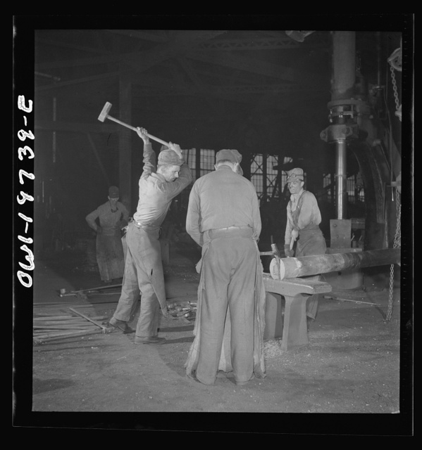 Topeka, Kansas. In the blacksmith shop of the Atchison, Topeka, and Santa Fe Railroad. In addition to the making of the railroad equipment, the blacksmith shop is used for making important repairs to the shop machinery. Here a piston is being hammered out for a drop hammer in another part of the building