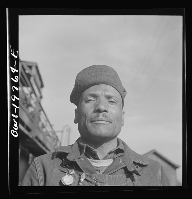 Topeka, Kansas. Manny Hughes, steel car repairer's helper and rivet heater, at the car shops of the Atchison, Topeka and Santa Fe Railroad