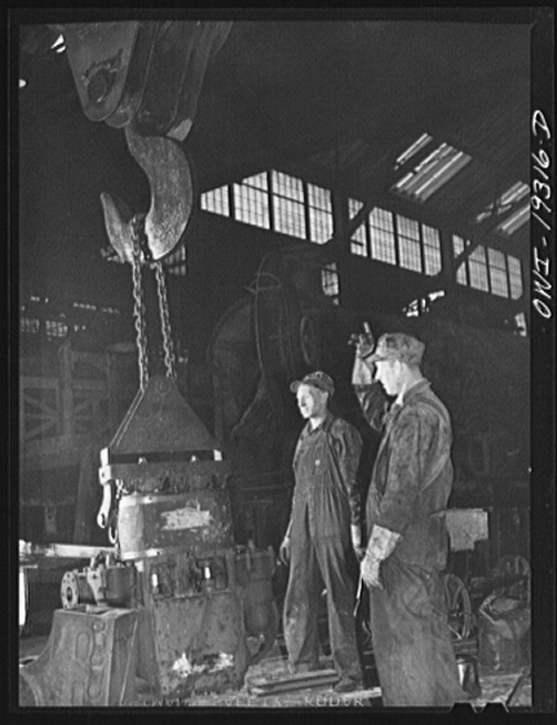 Topeka, Kansas. Raising the air pump of a locomotive at the Atchison, Topeka and Santa Fe Railroad locomotive shops