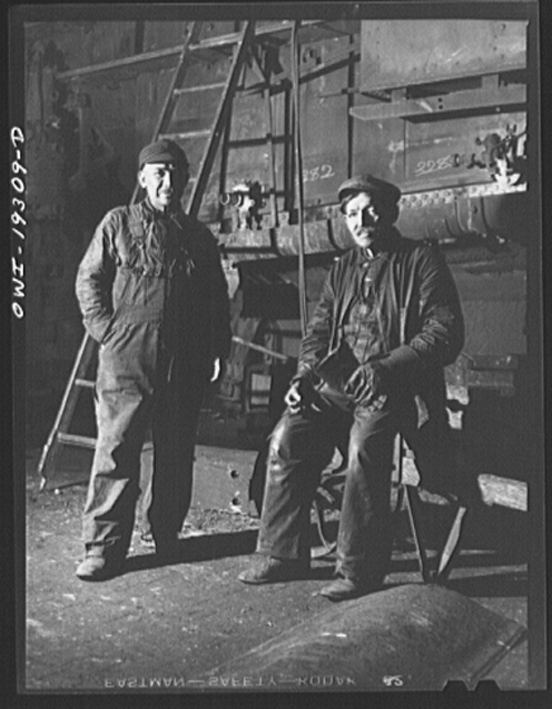 Topeka, Kansas. Two Mexican workers employed at the Atchison, Topeka and Santa Fe Railroad locomotive shops