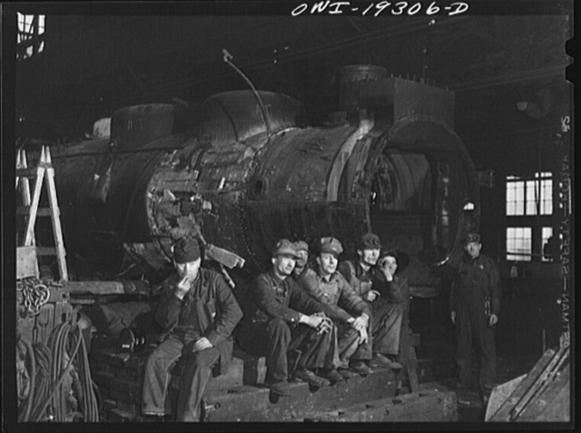 Topeka, Kansas. Workmen in the Atchison, Topeka and Santa Fe Railroad locomotive shops resting during lunch period
