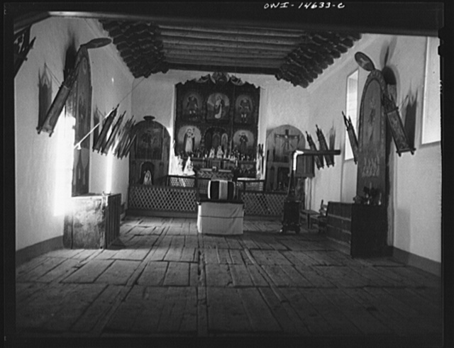 Trampas, New Mexico. A church which was built in 1700 and is the best-preserved colinal mission in the Southwest. Symbolic coffin placed in readiness for a memorial mass