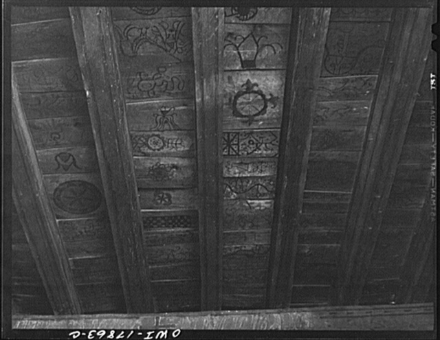 Trampas, New Mexico. Ceiling under the choir loft of a church which was built in 1700 and is the best-preserved colonial mission in the Southwest decorated with symbols