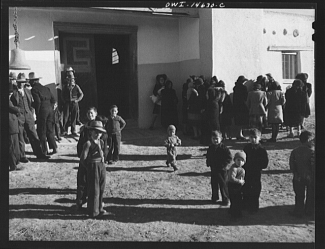 Trampas, New Mexico. Church-goers in the patio in front of the mission church of Santo Tomas