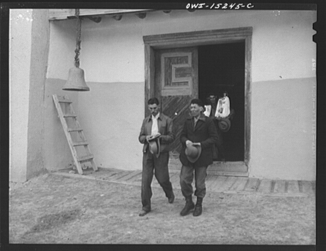 Trampas, New Mexico. Church which was built in 1700 and is the best-preserved colonial mission in the Southwest. These men are carrying santos from the church to their home three miles away; they will return them tomorrow
