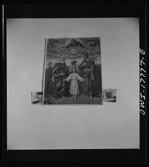 Trampas, New Mexico. Every room in the home of Juan Lopez, the majordomo (mayor), has three or four religious pictures
