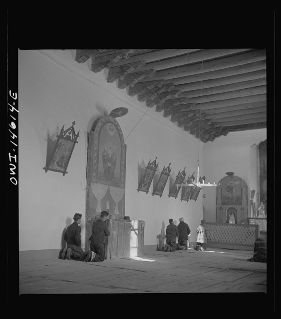 Trampas, New Mexico. Father Cassidy conducting mass at a church which was built in 1700 and is the best-preserved colonial mission in the Southwest