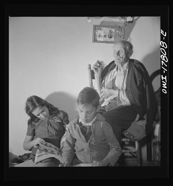 Trampas, New Mexico. Grandfather Romero, a member of the family of Juan Lopez, the majordomo (mayor), is ninety-nine years old. He has seen the old world change to the new