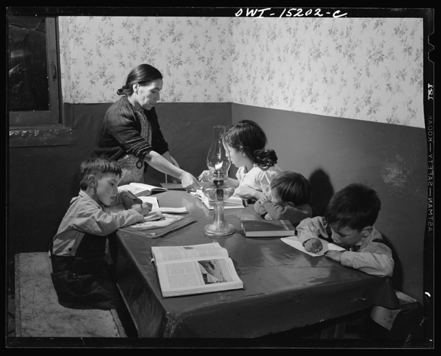 Trampas, New Mexico. Mrs. Maclovia Lopez, can read and write English well; she also keeps the family books in the evening and helps the children with their homework