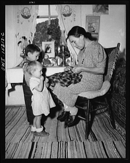 Trampas, New Mexico. Mrs. Maclovia Lopez, wife of the majordomo (mayor), is never idle; cooking, washing, spinning, and sewing are only some of her many responsibilities