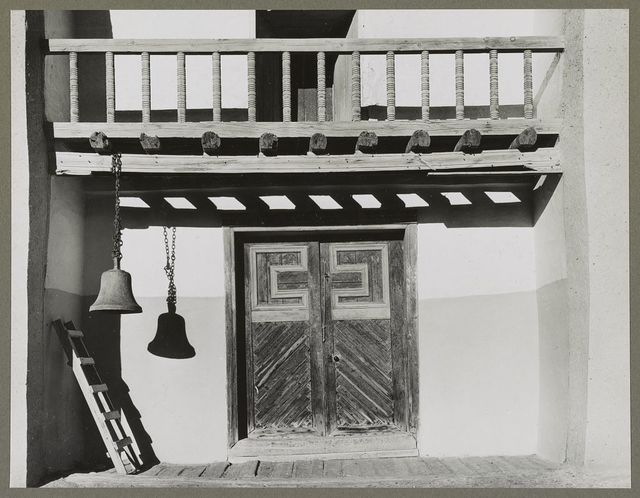 Trampas, New Mexico. Portal of a church built in 1700, the best-preserved colonial mission in the Southwest. The acolyte mounts the ladder and calls the congregation to mass by beating the bell with rocks held firmly in each hand