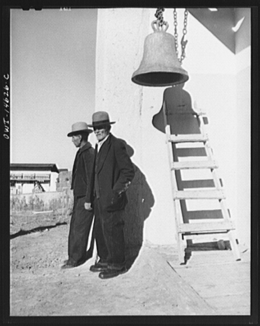 "Trampas, New Mexico. The bell ""Gracia"" on the left side of the entrance into the church"