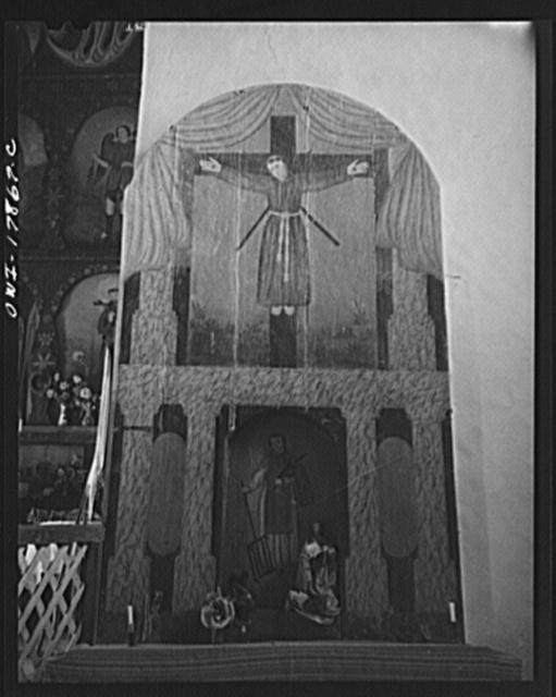 Trampas, New Mexico. The side altar to the right of the nave of a church which was built in 1700, and is the best-preserved colonial mission in the Southwest