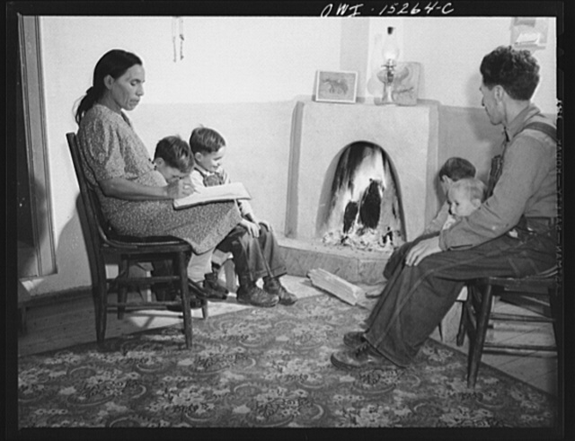 Trampas, New Mexico. The temperature in Trampas drops way below zero in winter, and all social life takes place around the fire. An evening scene in the home of Juan Lopez, the majordomo (mayor)