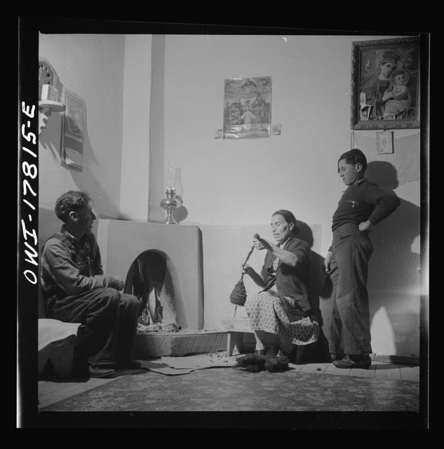 Trampas, New Mexico. The temperature of Trampas drops way below zero in winter, and all social life takes place around the fire. An evening scene in the home of Juan Lopez, the majordomo (mayor)