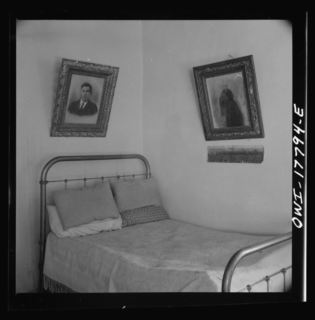 Trampas, New Mexico. Wall decorations in one of the bedrooms in the house of Juan Lopez, the majordomo