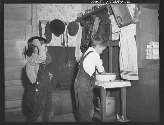 Trampas, New Mexico. Water is precious at the home of Juan Lopez, majordomo (mayor), but the family try hard to keep clean and neat, even though they do use the same water and the same towel