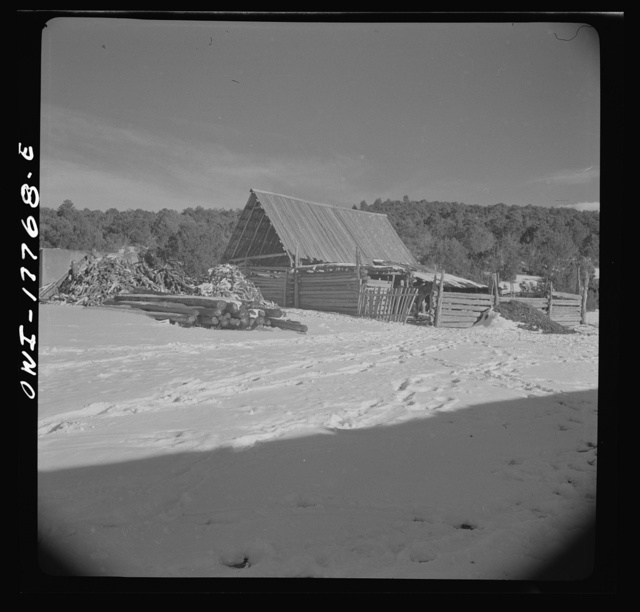 Trampas, Taos County, New Mexico. A Spanish-American village in the foothills of the Sangre de Cristo Mountains. Each house has its corral built of aspen and pine cut from the mountains above the village