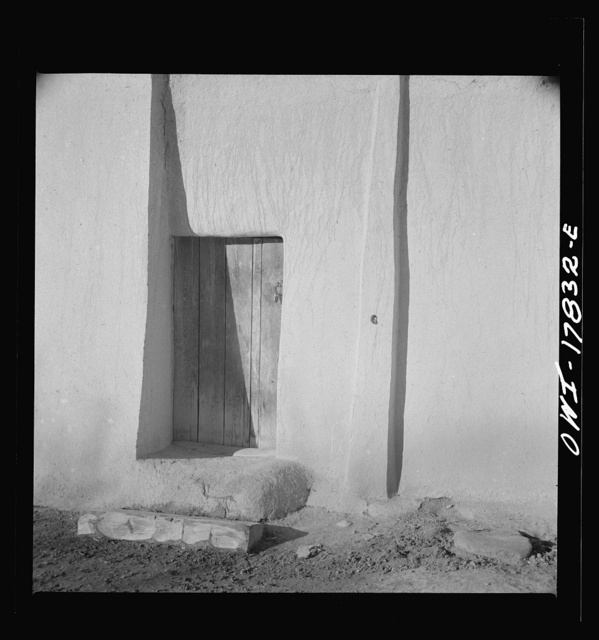 Trampas, Taos County, New Mexico. American village in the foothills of the Sangre de Cristo Mountains. Adobe construction is practical if it is kept up by replastering at least every two years