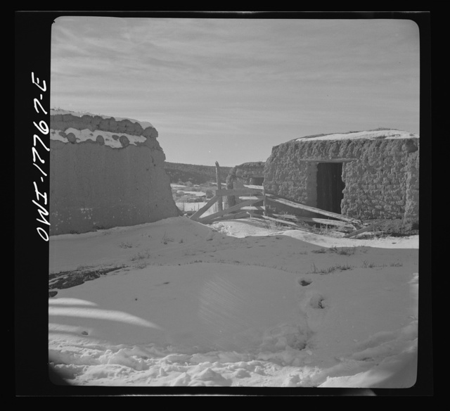 Trampas, Taos County, New Mexico. Deserted houses in a Spanish-American village in the foothills of the Sangre de Cristo Mountains. Once water eats in between the bricks, adobe houses crumble away quickly