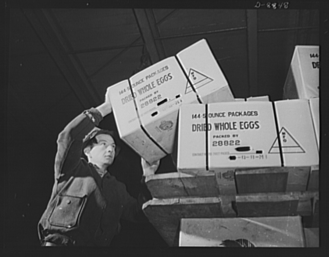 Transportation. Lend-lease shipments. Cases of dried whole eggs, part of a lend-lease shipment, move from a pier to a United Nations freighter that will carry them together with other vital necessities to one of our allies