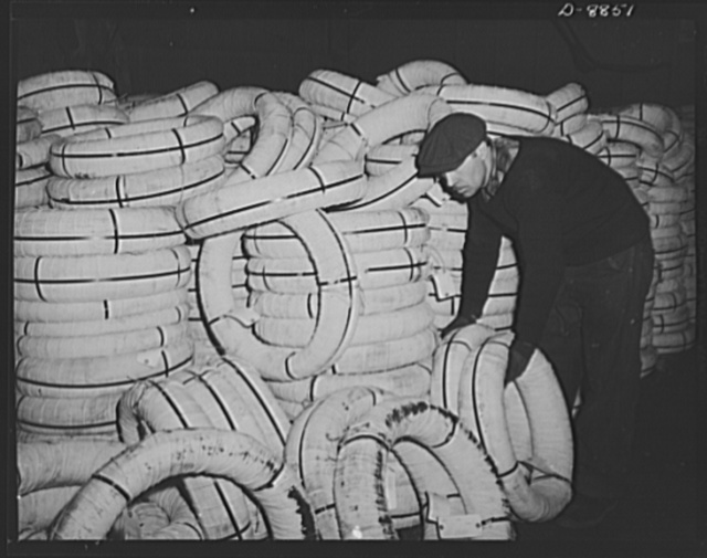 Transportation. Lend-lease shipments. Coils of copper wire, part of a lend-lease shipment, move from a pier to a United Nations freighter that will carry them together with other vital necessities to one of our allies