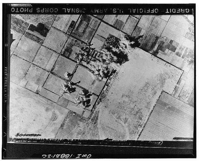 Tripoli, Libya. Daylight raid by Allied air forces on the Castel Benito airdrome, resulting in great damage to machine shops shown at the scene of the airdrome and other installations