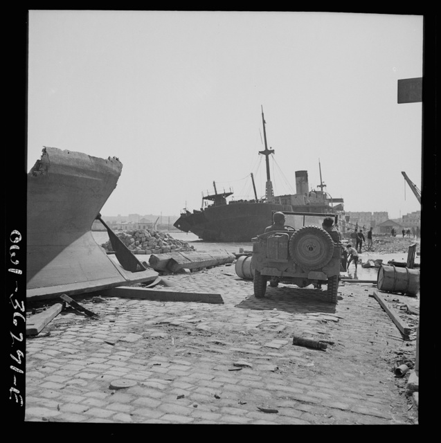 Tunis, Tunisia. American soldiers inspecting wrecked ships in Tunis harbor