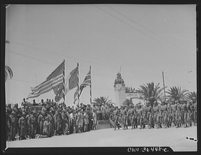 Tunis, Tunisia. American soldiers passing the stand in the Allied victory parade along Avenue Gambetta