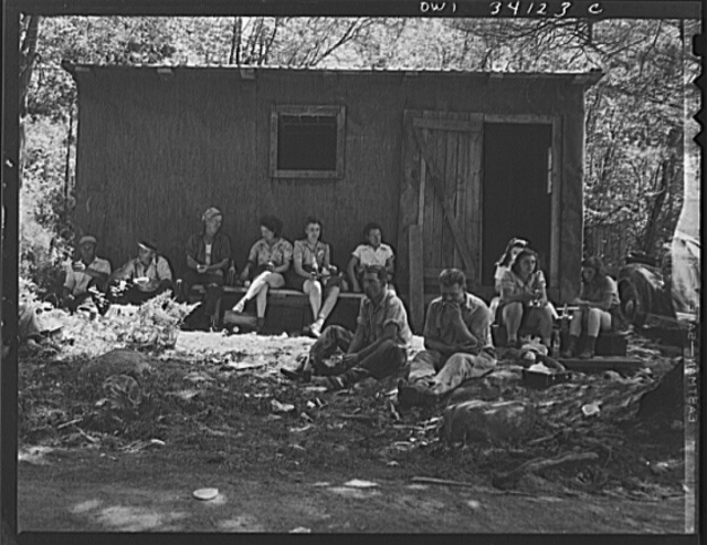 Turkey Pond, near Concord, New Hampshire. Women workers employed by a U.S. Department of Agriculture timber salvage sawmill. Employees bring their lunch, usually sandwiches and pop or a thermos jug of coffee. The two men at the far left have been rounding up logs on the pond, a job which they do at all the government mills in the vicinity by turns