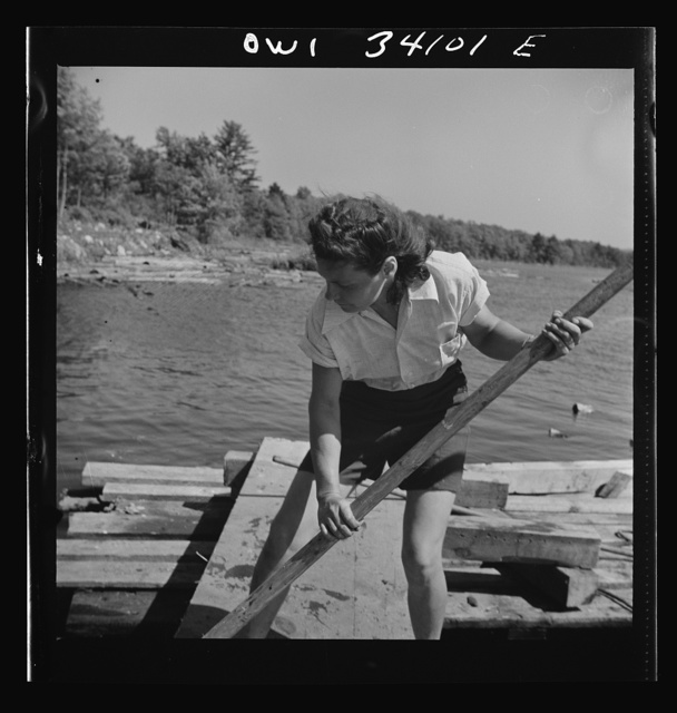 Turkey Pond, near Concord, New Hampshire. Women workers employed by a U.S. Department of Agriculture timber salvage sawmill. Mrs. Elizabeth Esty, a pond woman, pushing a log where she wants it with a pike