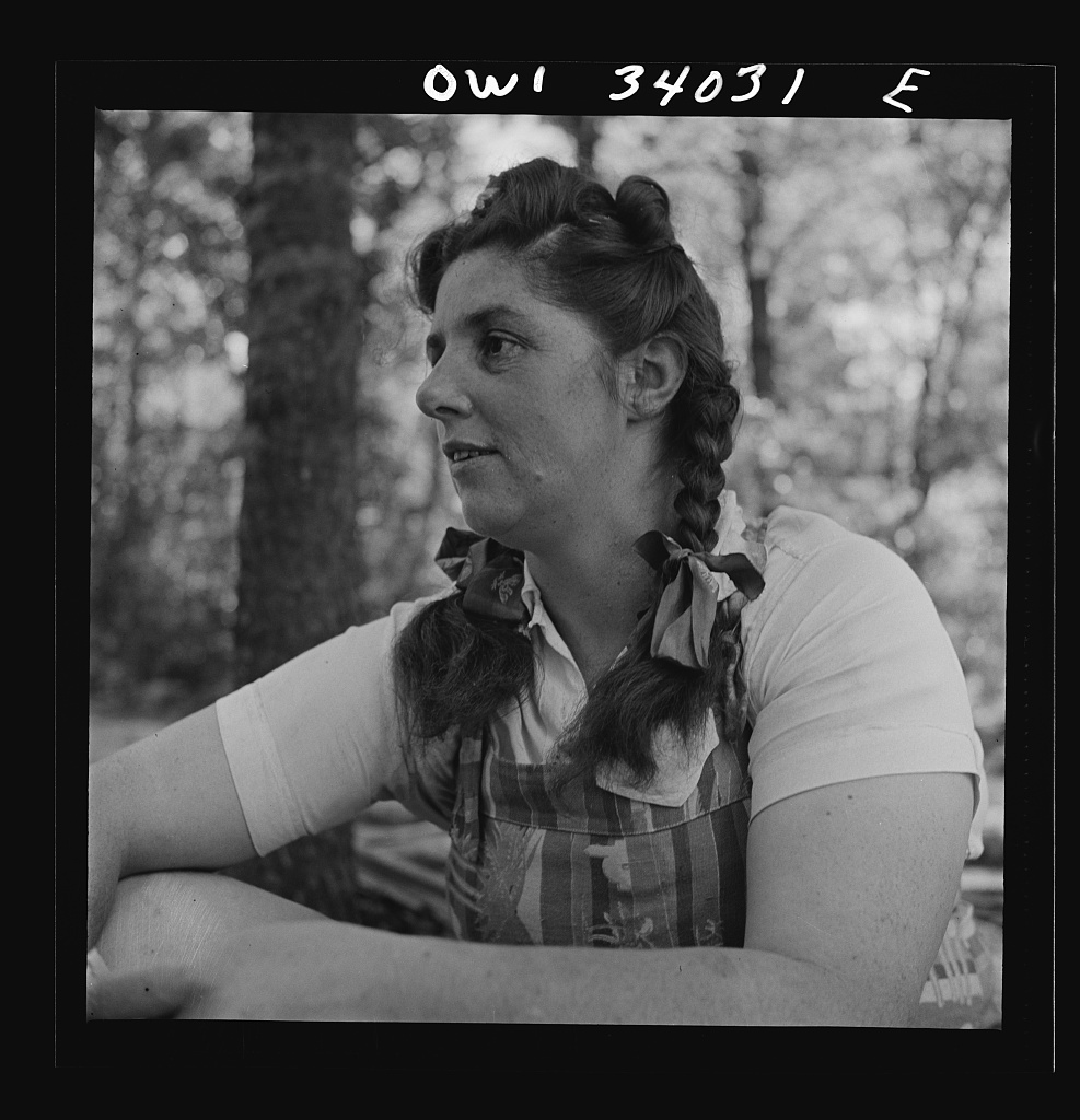 "Turkey Pond, near Concord, New Hampshire. Women workers employed by a U.S. Department of Agriculture timber salvage sawmill. Mrs. Violet Storey, ""takes away,"" is a farmer's wife with six children"