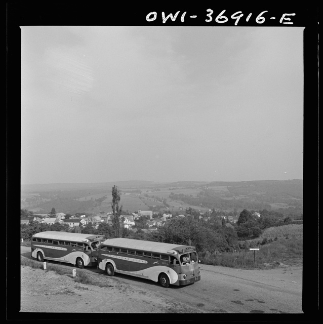 Two Greyhound buses going from Washington, D.C. to Pittsburgh, Pennsylvania