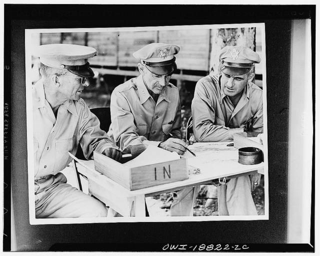United States Army ground and air generals confer with their Chief, Lieutenant General Millard F. Harmon, commanding Army forces in the South Pacific area, at the close of a successful Guadalcanal campaign. Major General Alexander M. Patch, Jr., left, who commanded the Guadalcanal ground action; General Harmon and Major General Nathan F. Twining, commanding the Army's Air Forces in the South Pacific; three soldiers cut from the same tough fiber