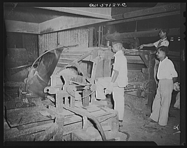 "United States ""lend-lease"" program in eastern India. Galvanizing sheets of steel which have been rolled. Lend-lease furnishes zinc for this important process"