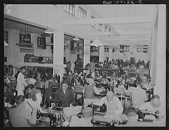 "United States ""lend-lease"" program in eastern India. Indian workmen turn out parachutes for their own Army. Lend-lease sewing machines have enabled this factory to expand its production enormously"