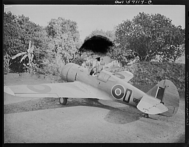"United States ""lend-lease"" program in eastern India. Mohawk fighter readies to take off at an air field in India. Planes like this one were originally build for the French and later taken over by the British under lend-lease. The ground crew stands in the background as an R.A.F. (Royal Air Force) pilot taxis his lend-lease Mohawk fighter to the runway"