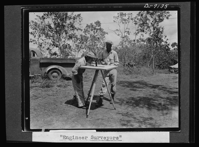 U.S. Negro troops in New Guinea. Part of a surveying crew of a Negro engineer unit. The two men shown in the picture received their basic training for surveying under the army's well-trained engineer officers. This photo was made in New Guinea where they are putting it now to practical use. Engineer task forces have proven an important factor in the New Guinea campaign